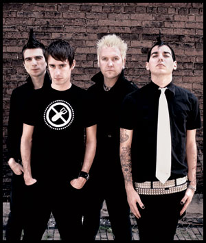 Anti-Flag: pro black shirts with white ties.