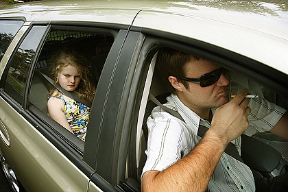 The little girl is sad because the windows are down. She prefers hot boxing.