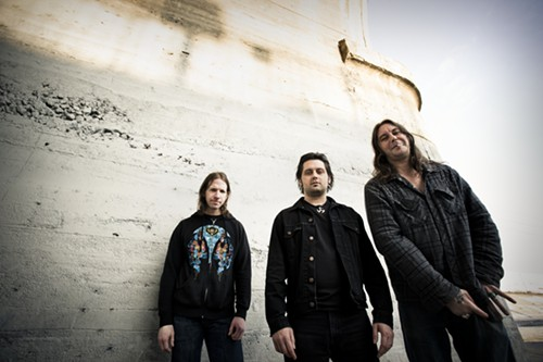Is that a gang sign the one High on Fire dude is throwing low?