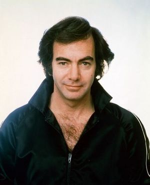 Neil Diamond and his chest hair celebrate their Rock Hall induction